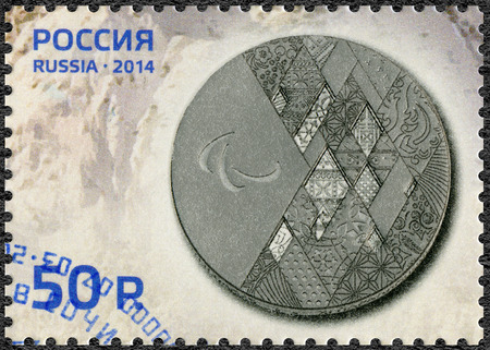 RUSSIA - CIRCA 2014: A stamp printed in Russia shows Silver medal, the XI Paralympic Winter Games in Sochi 2014, circa 2014
