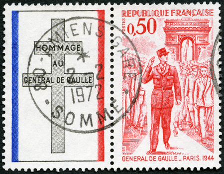 gaulle: FRANCE - CIRCA 1971: A stamp printed in France shows General de Gaulle entering Paris, 1944, circa 1971