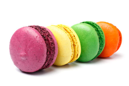 Colorful french macaroons on white background photo