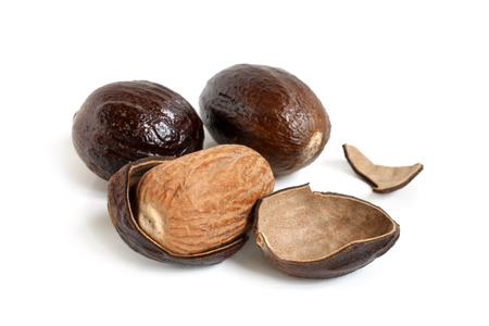 Nutmeg on white background photo