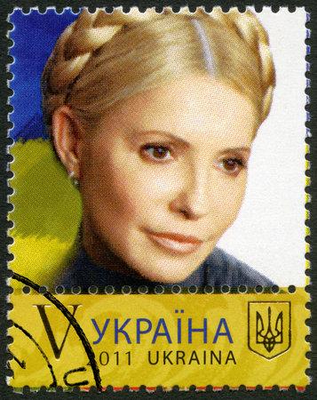 prime adult: UKRAINE - CIRCA 2011: A stamp printed in Ukraine shows Yulia Tymoshenko, circa 2011 Editorial