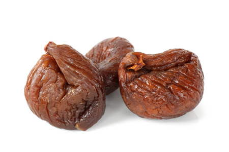 Dried figs on white background photo