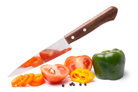 Fresh vegetables with knife on white background photo