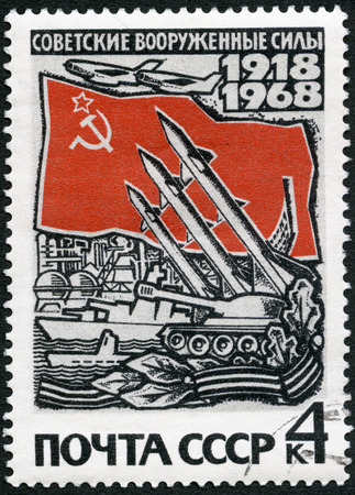 USSR - CIRCA 1968: A stamp printed in USSR shows Modern weapons and Russian flag, series 50th anniversary of the Armed Forces of the USSR, circa 1968