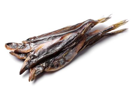 dried fish: Dried smelt on white background Stock Photo