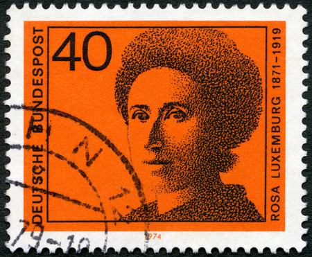 political economist: GERMANY - CIRCA 1974: A stamp printed in Germany shows Rosa Luxemburg (1871-1919), series Honoring German women writers and leaders in political and womens movements, circa 1974