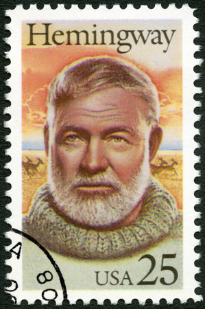 ernest hemingway: UNITED STATES OF AMERICA - CIRCA 1989: A stamp printed in USA shows Ernest Hemingway (1899-1961), Nobel Prize-winner for Literature, circa 1989