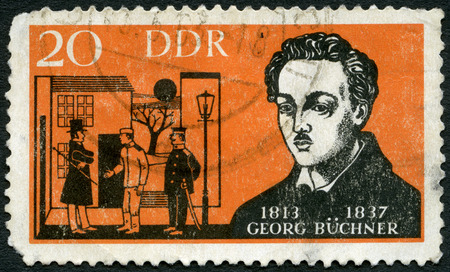 dramatist: GERMANY - CIRCA 1963: A stamp printed in Germany shows Georg Buchner (1813-1837), German dramatist, 150th anniversary birth, circa 1963