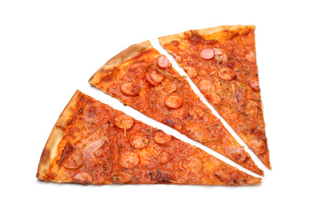 Slices of pizza on white background photo