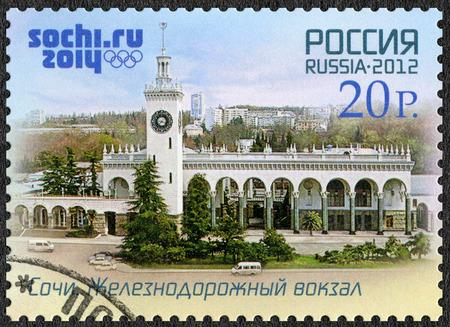 olympiad: RUSSIA - CIRCA 2012: A stamp printed in Russia shows railway station in Sochi, Russian Black Sea coast tourism, XXII Olympic Winter Games 2014 in Sochi, circa 2012 Editorial