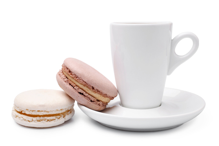 Cup of coffee  with colorful french macaroons on white background photo