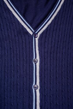 Closeup of blue cardigan, vertical picture photo
