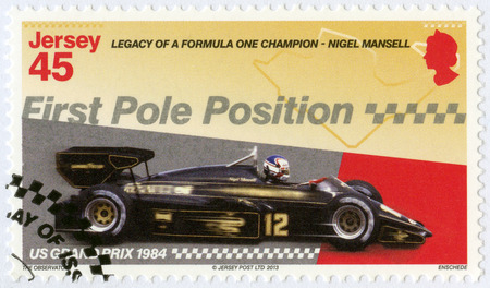 JERSEY - CIRCA 2013: A stamp printed in Jersey dedicated Nigel Mansell, First Pole Position, US Grand Prix 1984, Legacy of a Formula One champion - Nigel Mansell, circa 2013 Editorial