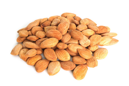 apricot kernel: Apricot seeds on white background Stock Photo