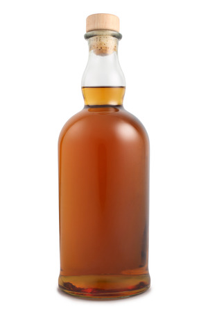 Bottle of alcoholic drink on white background Stock Photo
