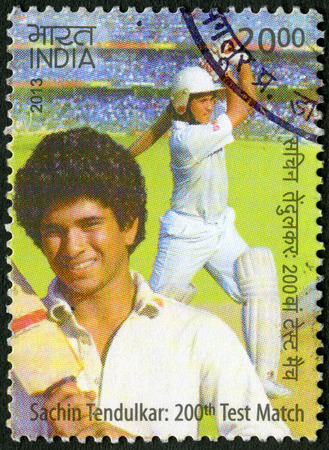 cricketer: INDIA - CIRCA 2013  A stamp printed in India shows Sachin Tendulkar, cricketer player, dedicated 200th Test Match, circa 2013