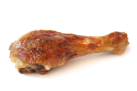 barbecued: Barbecued chicken leg on white background