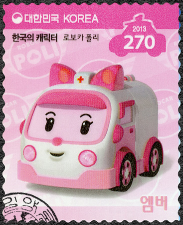 firstaid: SOUTH KOREA - CIRCA 2013: A stamp printed in South Korea shows Amber, the kind of ambulance which administers first-aid, series Brooms Town Rescue Team, circa 2013
