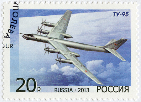 RUSSIA - CIRCA 2013: A stamp printed in Russia shows Bomber Tu-95, for the 125th Birth Anniversary of A.N. Tupolev, circa 2013