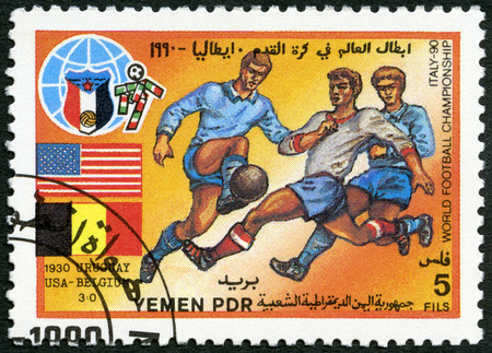 YEMEN PDR - CIRCA 1990: A stamp printed in Yemen PDR shows Soccer game, US, Belgium, 1930, History of World Cup Soccer Championships, circa 1990