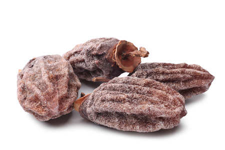 ebony: Dried persimmon on white background