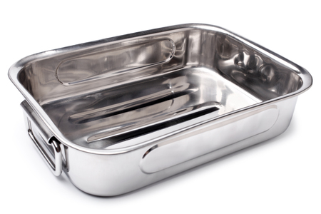 Stainless steel roasting pan on white background photo