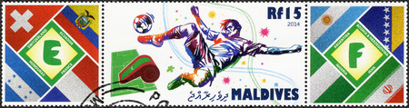 MALDIVES - CIRCA 2014: A stamp printed in Maldives dedicated the 2014 FIFA World Cup Brazil, June 12 -  July 13, circa 2014