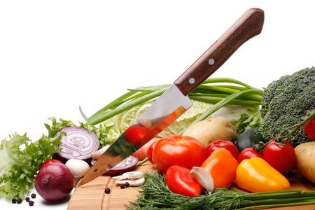 knife tomato: Fresh vegetables with knife on white background Stock Photo