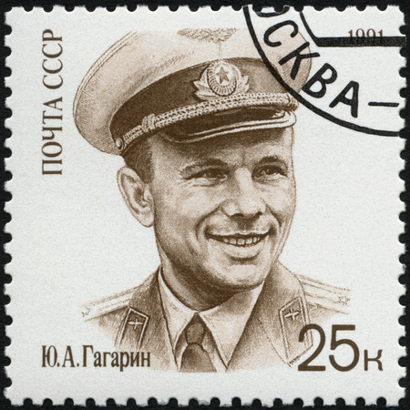 USSR - CIRCA 1991: A stamp printed in USSR shows Yuri A. Gagarin (1934-1968), cosmonaut, wearing hat, circa 1991