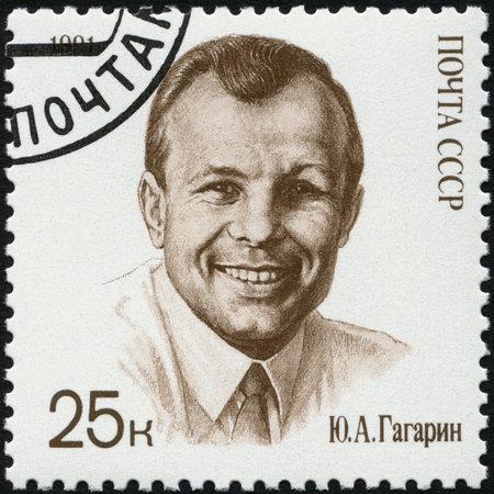 yuri: USSR - CIRCA 1991: A stamp printed in USSR shows Yuri A. Gagarin (1934-1968), cosmonaut, as civilian, circa 1991