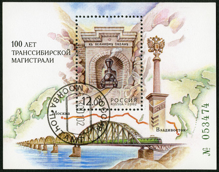 mainline: RUSSIA - CIRCA 2002: A stamp printed in Russia shows Transsiberian highway railway bridge and map of Eurasia, dedicated the 100th anniversary of the Transsiberian highway, circa 2002