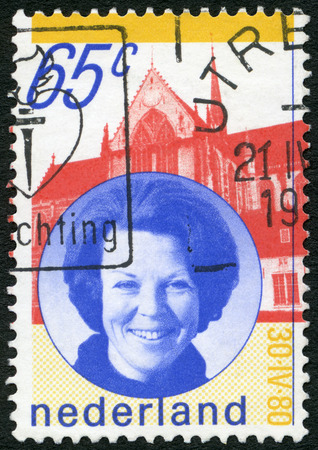 NETHERLANDS - CIRCA 1980: A stamp printed in Netherlands shows Portrait of Queen Beatrix, Palace, circa 1980