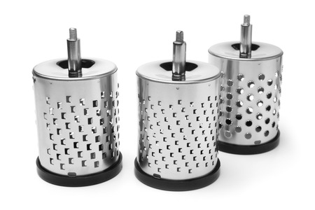 Drums for universal grater on white background photo