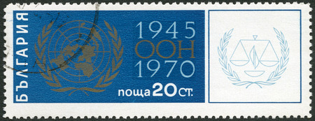 postmail: BULGARIA - CIRCA 1970: A stamp printed in Bulgaria shows UN Emblem, 25th anniversary of the United Nations, circa 1970 Editorial