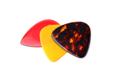 ribbed slab: Colourful guitar plectrums on white background