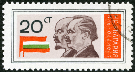BULGARIA - CIRCA 1969: A stamp printed in Bulgaria shows Lenin, Dimitrov, Russian and Bulgarian flags, dedicated the 25th anniversary of Peoples Republic, circa 1969