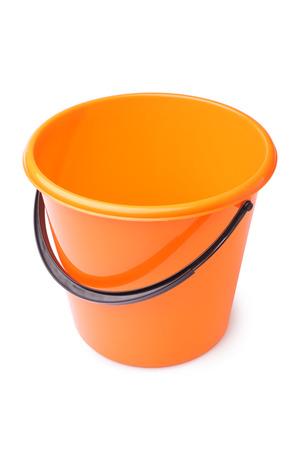 Orange plastic bucket on white background photo