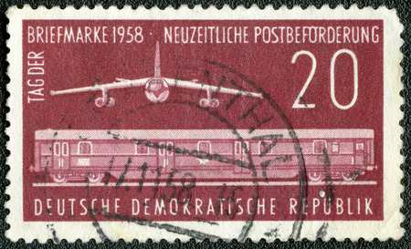railway history: GERMANY - CIRCA 1958: A stamp printed in Germany shows Mail train and plane, Issued for the Day of the Stamp, circa 1958 Editorial