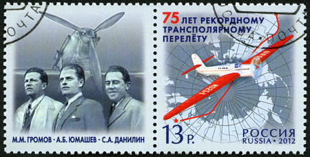 vp: RUSSIA - CIRCA 2012: A stamp printed in Russia shows ANT-25 aircraft, M.M Gromov, A.B. Yumashev and S.A. Danilin, devoted the 75 anniversary of non-stop flight of crew of V.P. Chkalov, circa 2012 Editorial