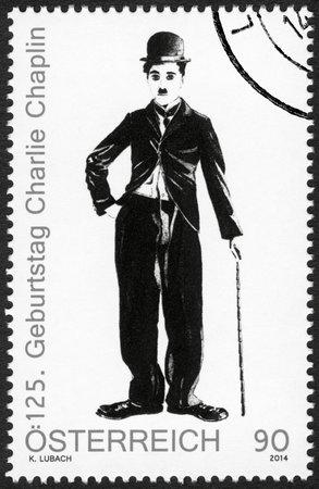 spencer: AUSTRIA - CIRCA 2014: A stamp printed in Austria shows portrait of Charlie Chaplin (1889-1977), 125th anniversary of birthday, circa 2014