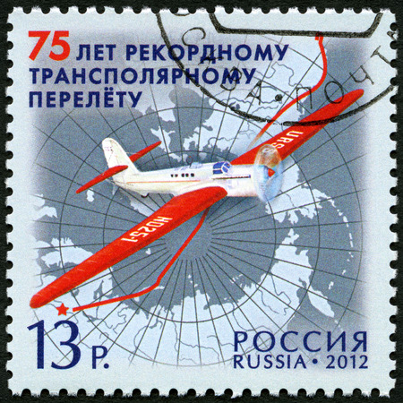 vp: RUSSIA - CIRCA 2012: A stamp printed in Russia shows ANT-25 aircraft, devoted the 75 anniversary of non-stop flight of crew of V.P. Chkalov, circa 2012 Editorial