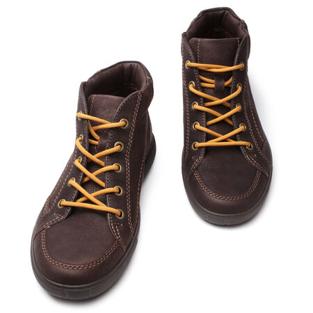 shoestrings: Leather brown boots on white background