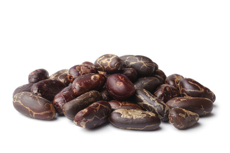 Cacao beans on white background photo