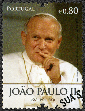paulus: PORTUGAL - CIRCA 2010: A stamp printed in Portugal shows Paus Johannes Paulus II (1920-2005), devoted Pope Bento XVI visits Portugal, circa 2010