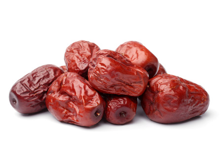Dried jujube fruits on white background