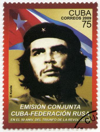che guevara: CUBA - CIRCA 2009: A stamp printed in Cuba shows commander Ernesto Guevara de la Serna (Che Guevara) and the Republic of Cuba national flag, the 50th anniversary of the Cuban revolution Victory, Joint issue Russian Federation – Republic of Cuba, circa 2