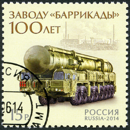 barricades: RUSSIA - CIRCA 2014: A stamp printed in Russia shows Topol-M, dedicated 100 years of the factory Barricades, circa 2014