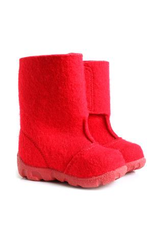 children s feet: Children winter felt boots on white background Stock Photo