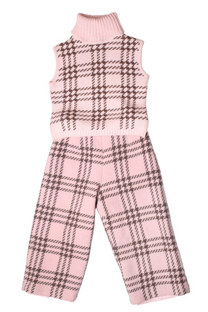 Baby girls trousers and sleeveless pullover isolated on white background photo