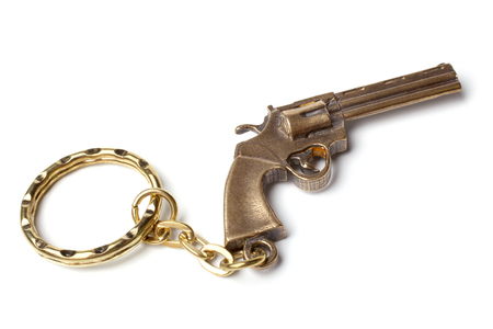 Trinket for the keys as a revolver on a white background photo